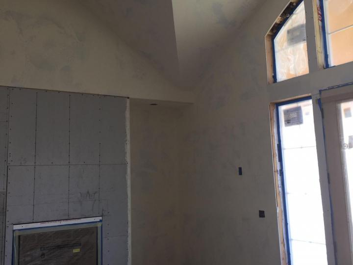 main room fireplace before paint textured